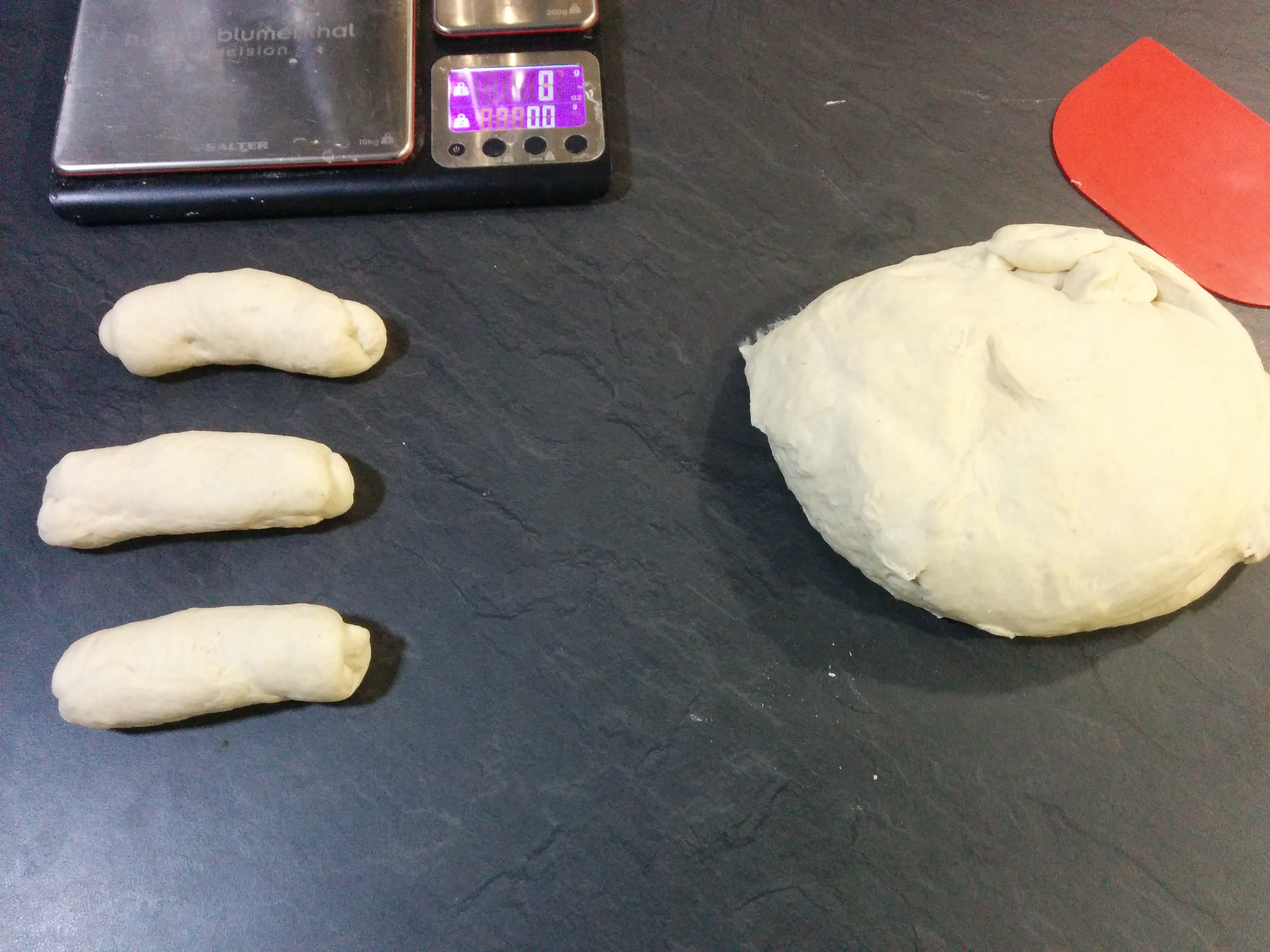 Partially portioned and preshaped dough