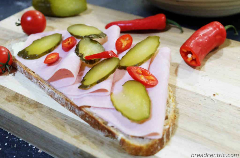 Silesian sourdough sandwich with ham, cucumber and chili