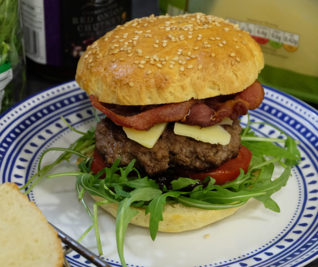 Burger with rocket, red onion chutney, cheddar and bacon